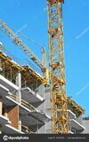 depositphotos_140793748-stock-photo-crane-and-highrise-construction-site